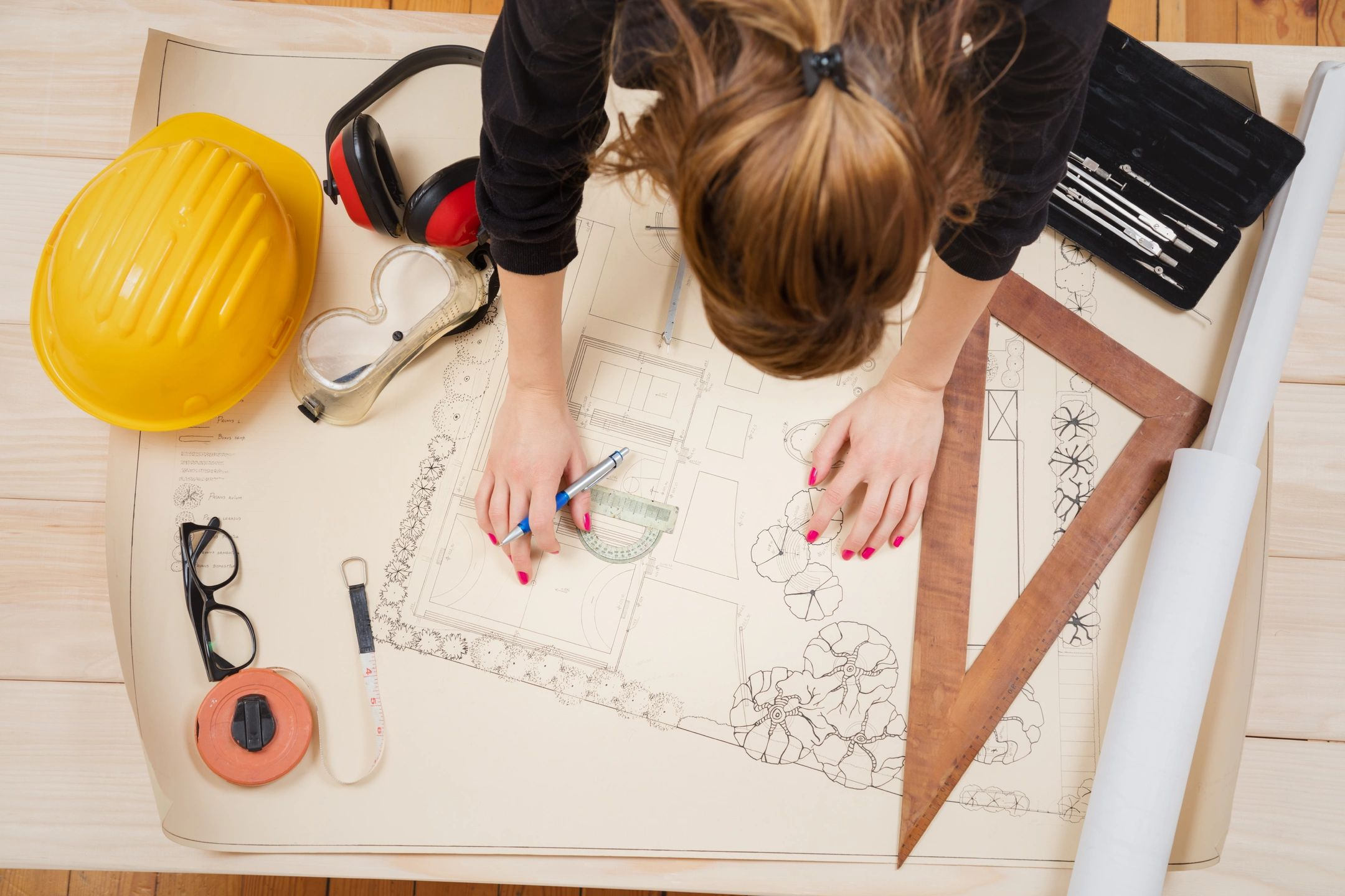 Woman working on a landscape design project